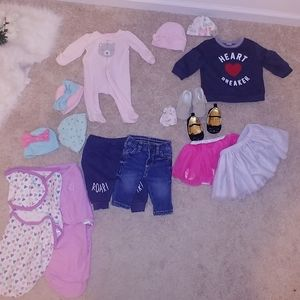 Bundles of baby clothes and shoes